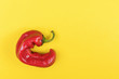 canvas print picture - Trendy Ugly red chilli peppers on yellow background, minimal nature style, pop-art, creative food concept