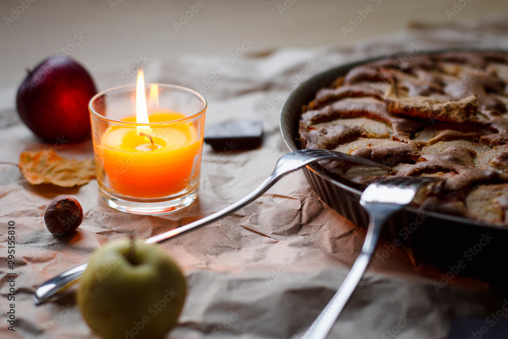 Fototapety, obrazy: a simple dessert of Apple pie in the evening by candlelight in autumn