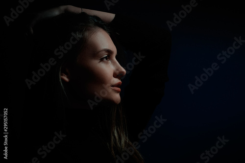 portrait of fashion model beautiful girl with freckles in studio, close up, beautiful girl young woman