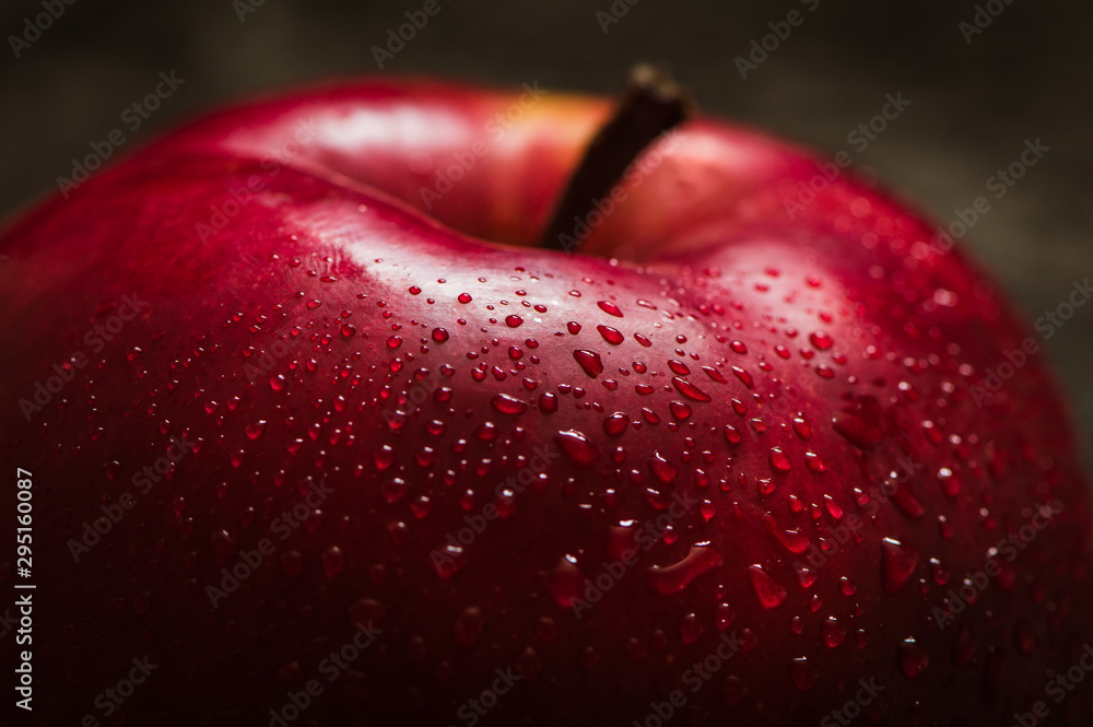 Fototapety, obrazy: Apple red. Close-up of an apple. Water spray droplets.