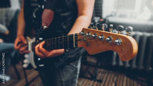 Rock band studio rehearsal. Male musician playing bass guitar before live concert. - 295171412
