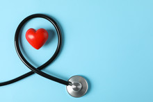 Stethoscope And Heart On Blue Background, Top View