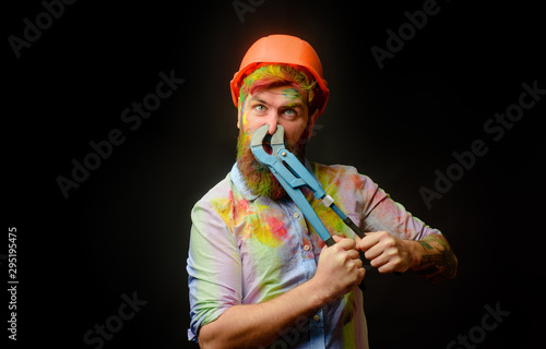 Photo  Construction worker, builder with pipe wrench