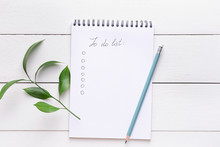 Empty To Do List And Pencil On White Wooden Background