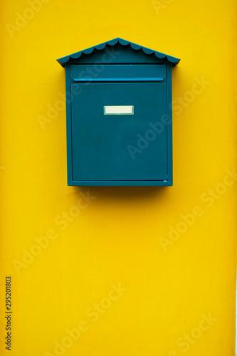 Obraz na plátně  Elegant simple green mail box on a yellow wall.