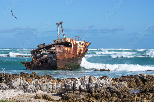 Photo Stands Ship old fishing boat in the sea