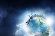 canvas print picture - Earth planet with city skyline on sky and space background