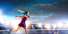 Young Woman Playing Tennis In ...