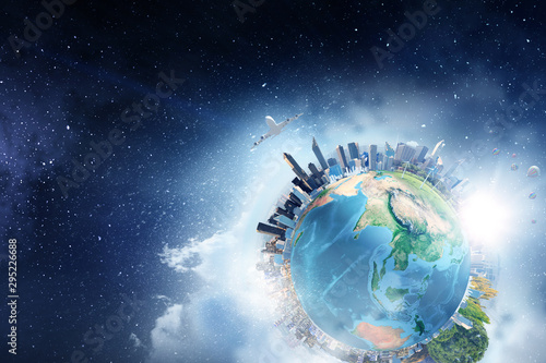 Earth planet with city skyline on sky and space background - 295226688