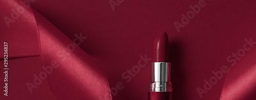 Canvastavla Luxury lipstick and silk ribbon on maroon holiday background, make-up and cosmet