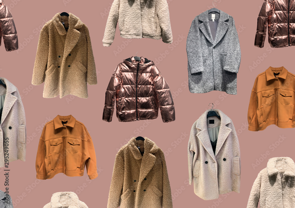 Fototapeta Fashionable winter jacket with fur. Composition of clothes isolated on pink. Flat lay, top view, copy space. Ladies' Trench Coat. Winter clothes pattern. Strict classic brown coat. Banner concept