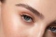 young girl open eyes with natural makeup close up