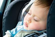 Cute Little Boy Sleeping In Ca...