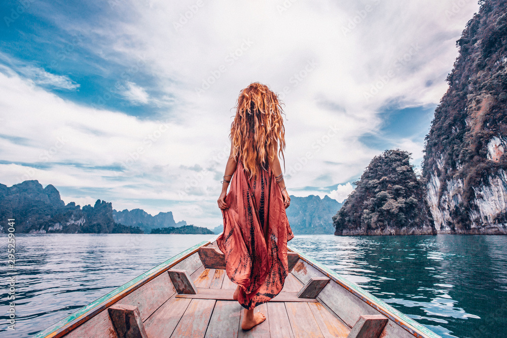 Fototapety, obrazy: fashionable young model in boho style dress on boat at the lake