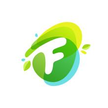 Letter F Logo At Green Watercolor Splash Background.