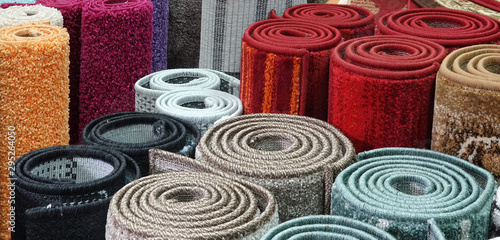 Photo Carpets variety selection rolled up rugs shop store