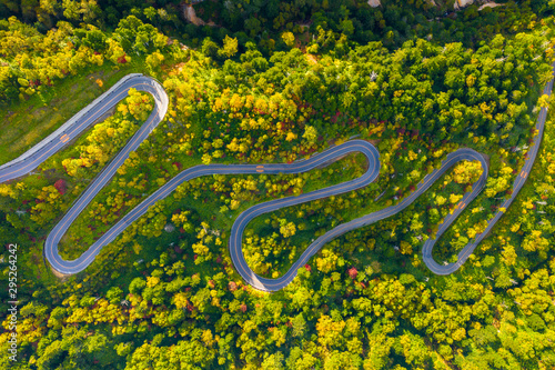 Aerial view of winding road on mountain in Autumn Tablou Canvas