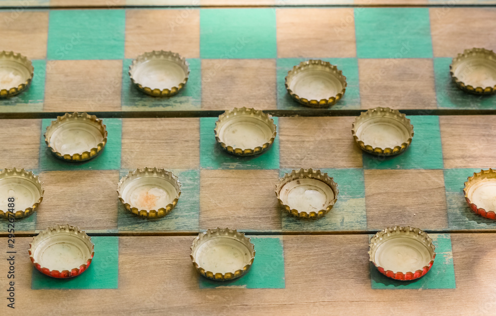 Fototapety, obrazy: jeu de dames avec capsules comme pions