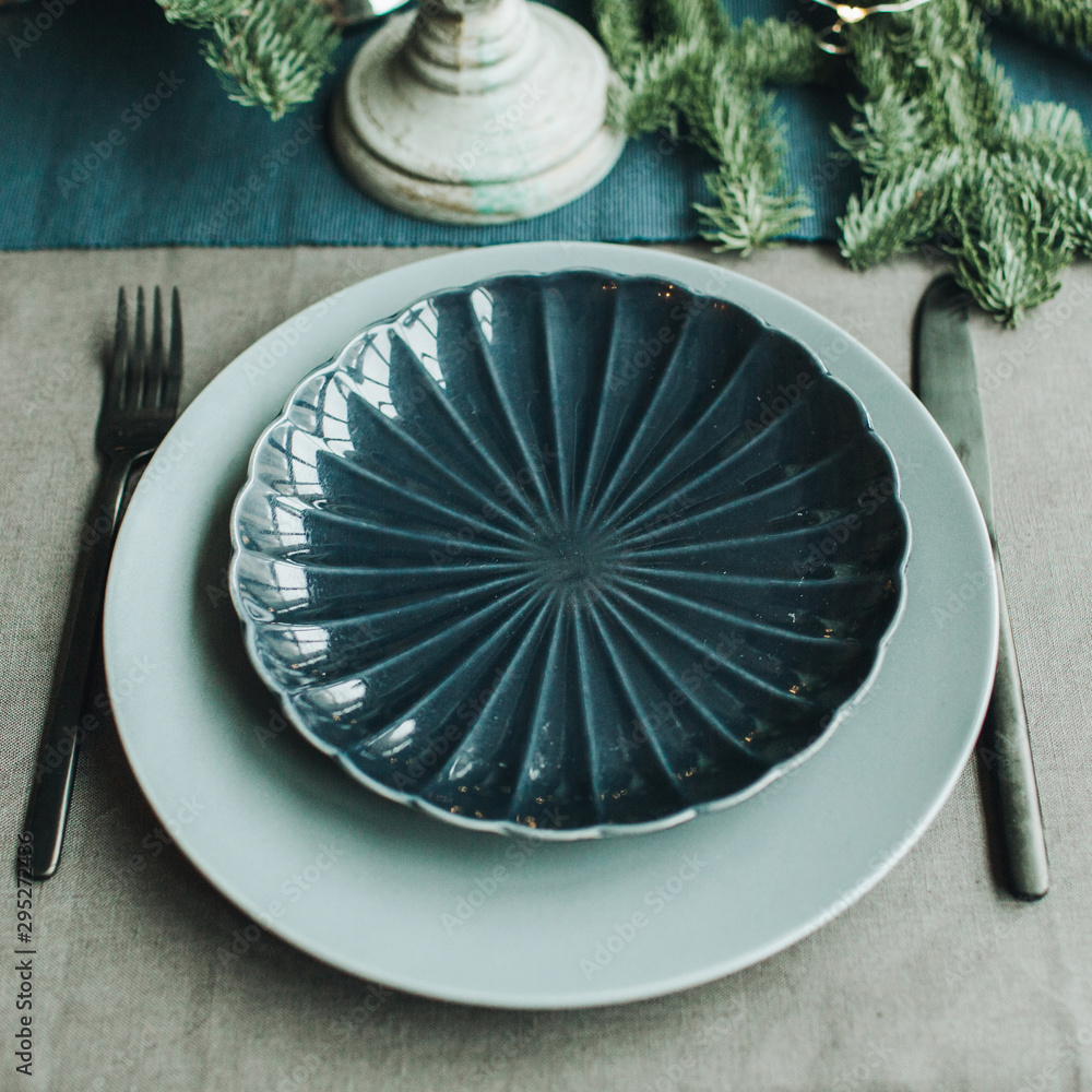 Fototapety, obrazy: Christmas / New Year composition. Festive christmas / Thanksgiving table decorated with fir branches, plate, knife, fork. Flat lay, top view. Winter holidays concept.