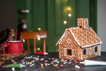 Making Christmas Gingerbread House. Traditional Christmas Baking And Cookies.