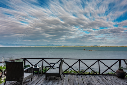 Sunrise at lake Malawi with cloudy sky, long exposure