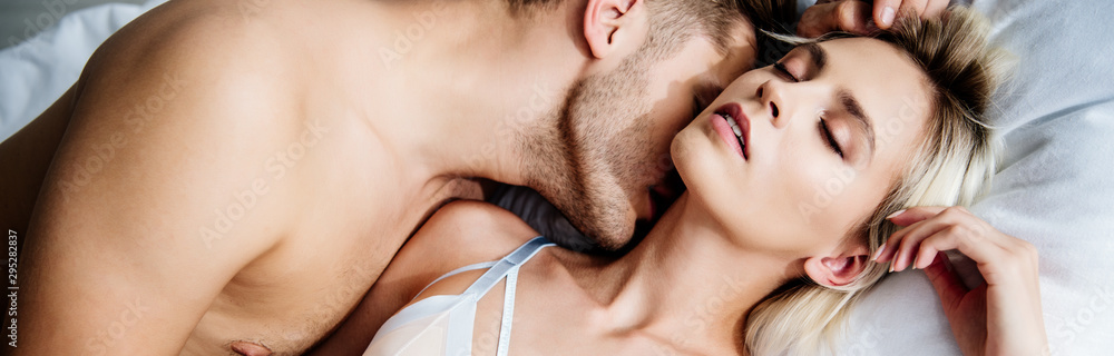 Fototapety, obrazy: panoramic shot of man kissing attractive woman with closed eyes