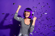 Leinwanddruck Bild - Portrait of excited pretty lady raising fists screaming yeah isolated over purple violet background