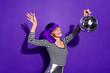 Leinwanddruck Bild - Portrait of excited youth holding mirror ball screaming moving wearing eyeglasses eyewear isolated over purple violet background