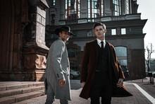 Two Fashion Men On Urban Backg...