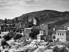 Black And White Image Of The Medieval Castle Village Of Vathia On A Cliff Above The Sea In Mani, Peloponnese, Greece.