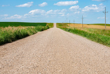 Gravel Road With Power Lines