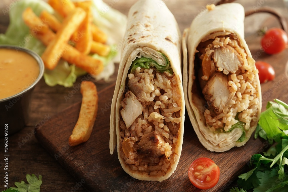 Fototapety, obrazy: Burritos Wrap with grilled chicken rice and veggies on wooden background, selective focus