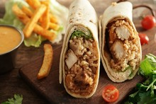 Burritos Wrap With Grilled Chicken Rice And Veggies On Wooden Background, Selective Focus