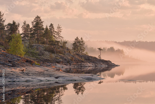 Fotografie, Obraz Solar fog on lake Ladoga, Republic of Karelia, Russia