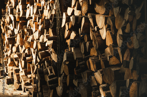 Wall firewood , Background of dry chopped firewood logs in a pile. Harvesting firewood for the winter. Harvesting firewood for the winter.