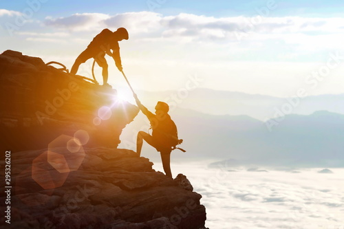 Canvas Print Climbing team are on the climb to the cliff,hiking and team work concept