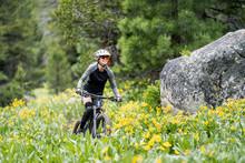 Female Mountain Biker In Flowe...