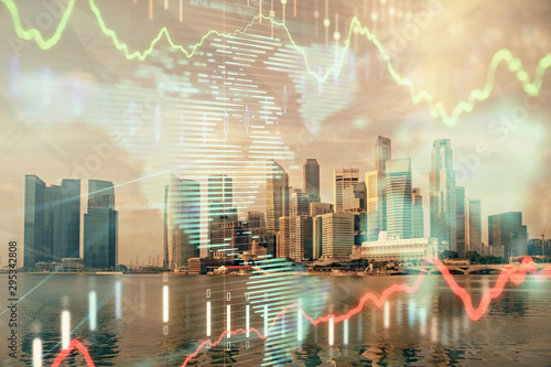 Forex chart on cityscape with tall buildings background multi exposure Canvas Print
