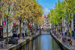 canvas print picture - Amsterdam street with canal with old houses