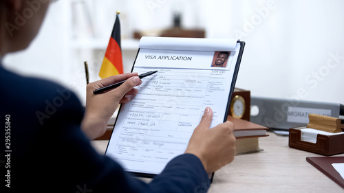 Immigration officer checking visa application office, german flag, migration Canvas-taulu