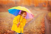 Happy Girl With Rainbow Umbrel...