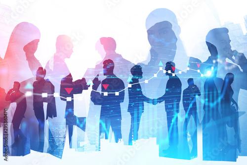 Obraz na plátně  Silhouettes of business partners, digital charts