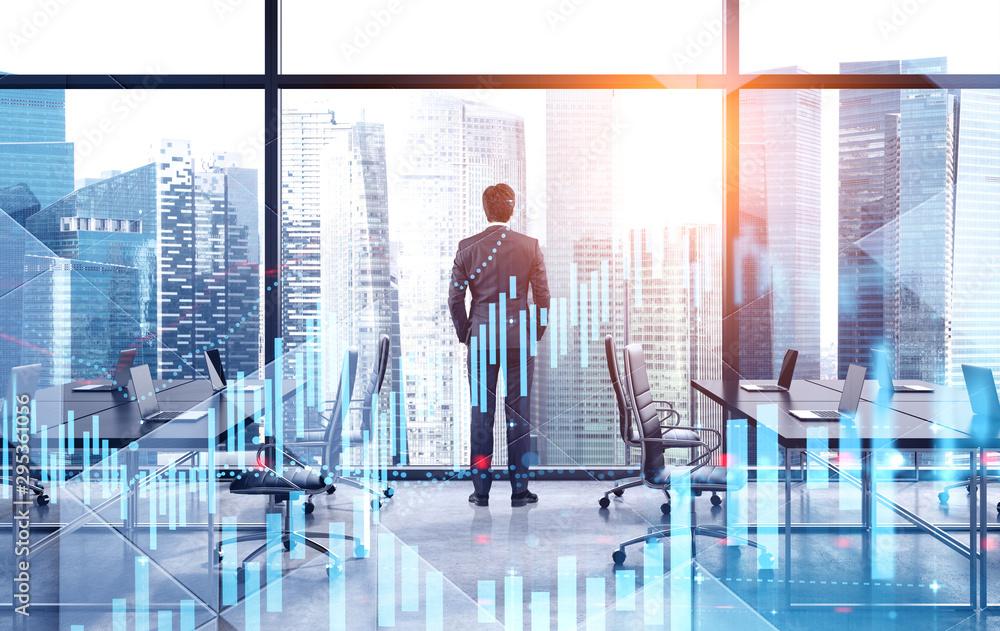 Fototapeta Young broker working in office, digital graphs
