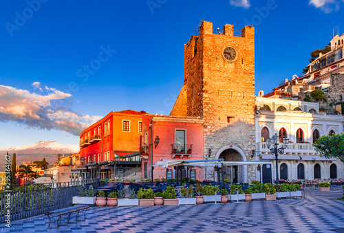 Fotobehang Oude gebouw Taormina, Sicily, Italy: Panoramic view of the morning square Piazza IX Aprile with the Clock Tower and Mount Etna Volcano on background