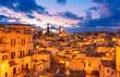 Leinwanddruck Bild - Matera, Basilicata, Italy: Night view of the old town - Sassi di Matera