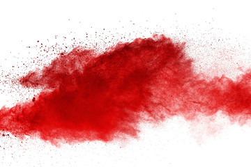 Red powder explosion on white background. Colored cloud. Colorful dust explod...