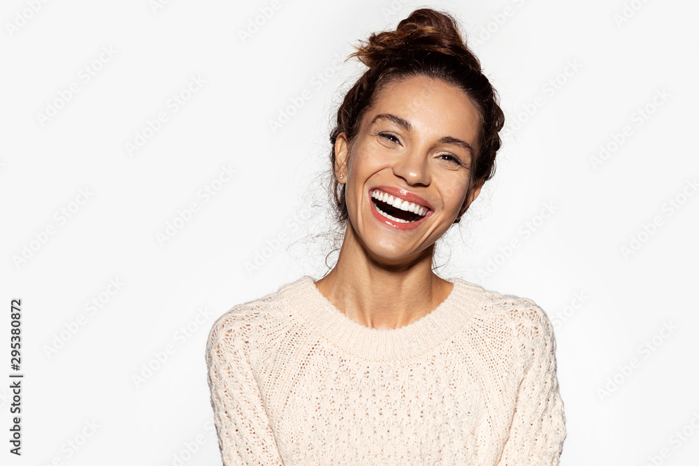 Fototapety, obrazy: Portrait of cheerful model laughing at something. Pretty young woman in beige pullover. Brunette girl in good mood. Happiness and beauty concept. Isolated on white background