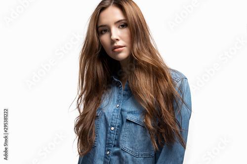 Studio fashion portrait of stylish woman wearing trendy jean jacket posing on white background Tableau sur Toile