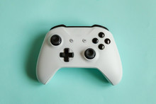 White Joystick Gamepad, Game Console Isolated On Pastel Blue Colourful Trendy Background. Computer Gaming Competition Videogame Control Confrontation Concept. Cyberspace Symbol