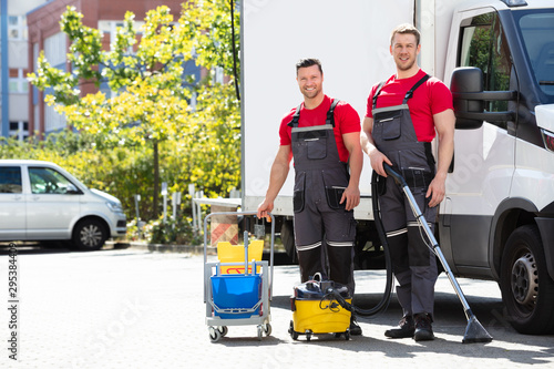 obraz lub plakat Male Janitors With Cleaning Equipment